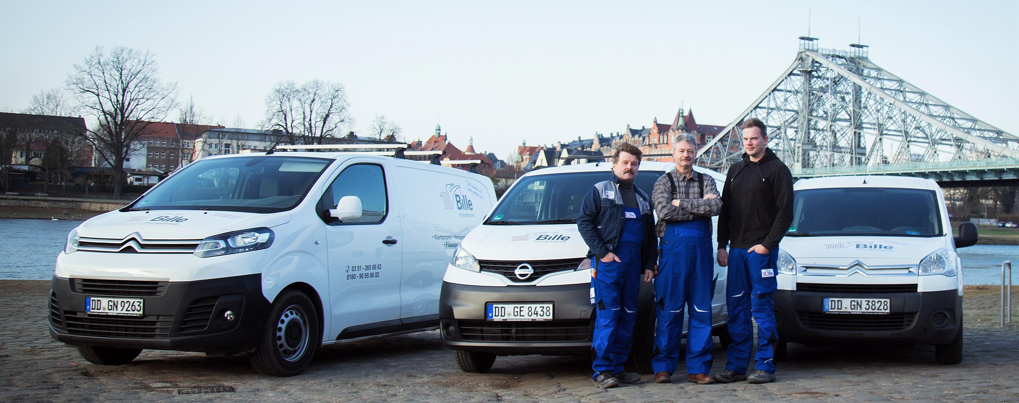 Meister Bille und Team vor blauem Wunder Dresden